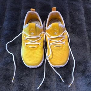 Pharrell Williams and adidas tennis shoes.